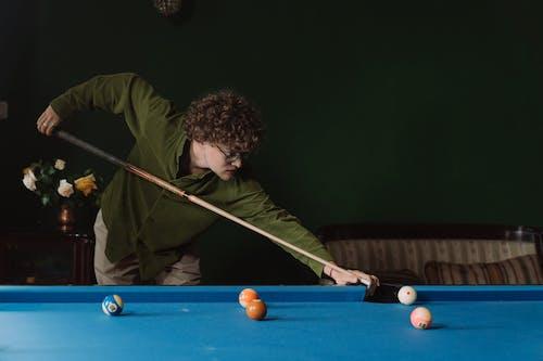 Man in Green Long Sleeve Shirt Playing Billiard