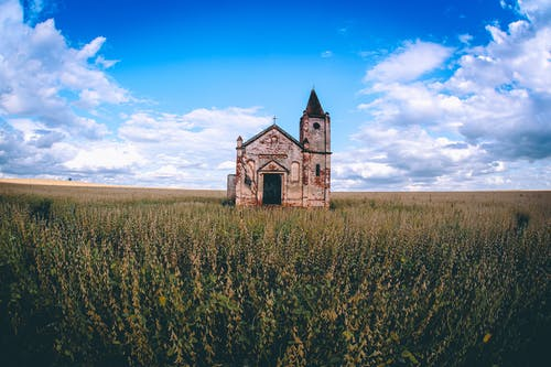 Lonely church in field in countryside