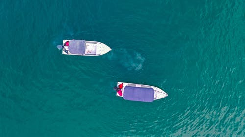 Small boats floating in turquoise water
