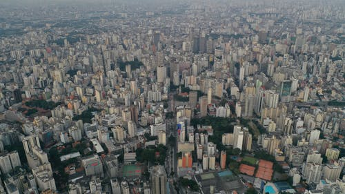 Tall buildings in misty district of megapolis