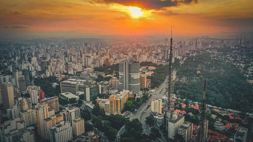Breathtaking sunset over modern city with towers