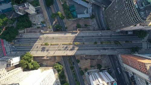 Urban district with asphalt roads and bridge