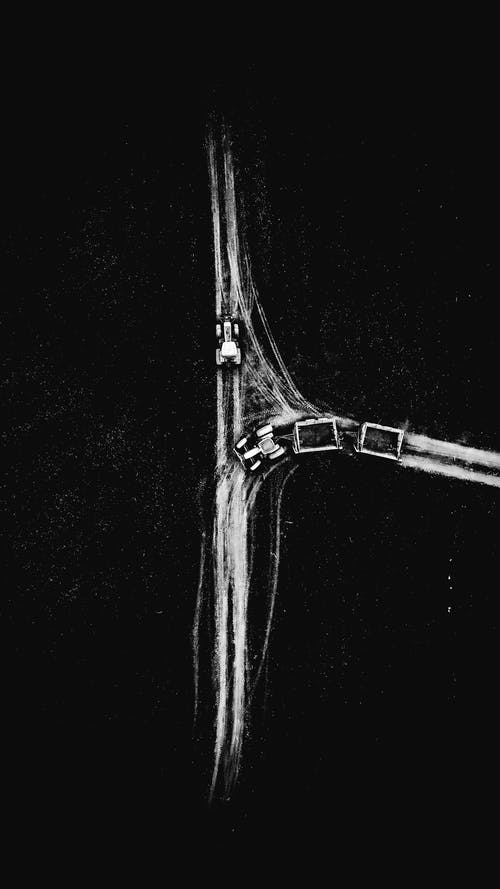 Black and white of road with cars in countryside