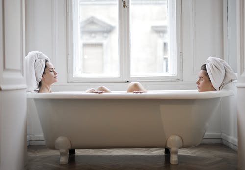 Woman in White Bath Tub