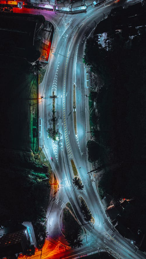 Luminous empty asphalt road of modern city