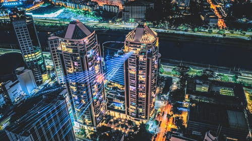 Sparkling modern skyscrapers with bright geometric lights
