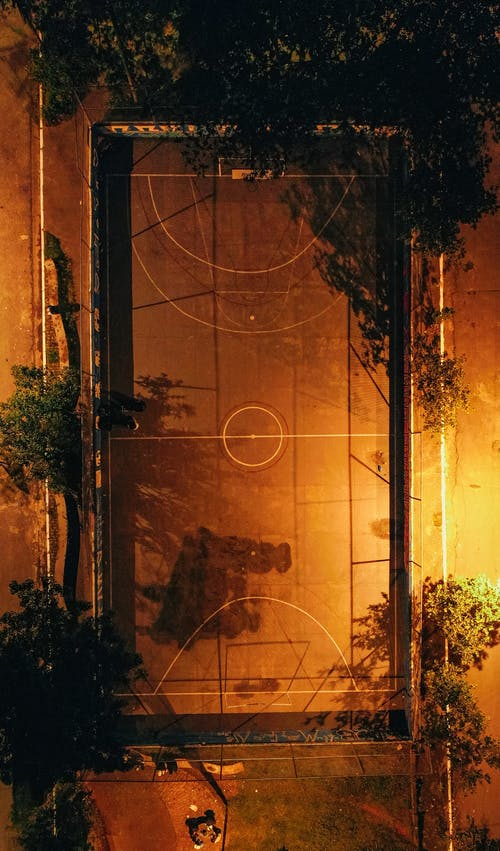 Sports ground with basketball hoop at night