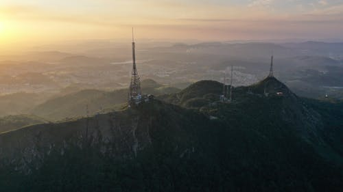 Hilly terrain with telecommunication towers at sunrise