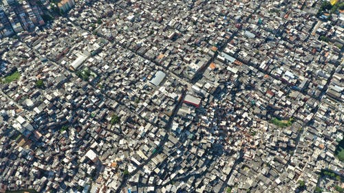 Aerial view of residential houses located close to each other along roads in densely built city
