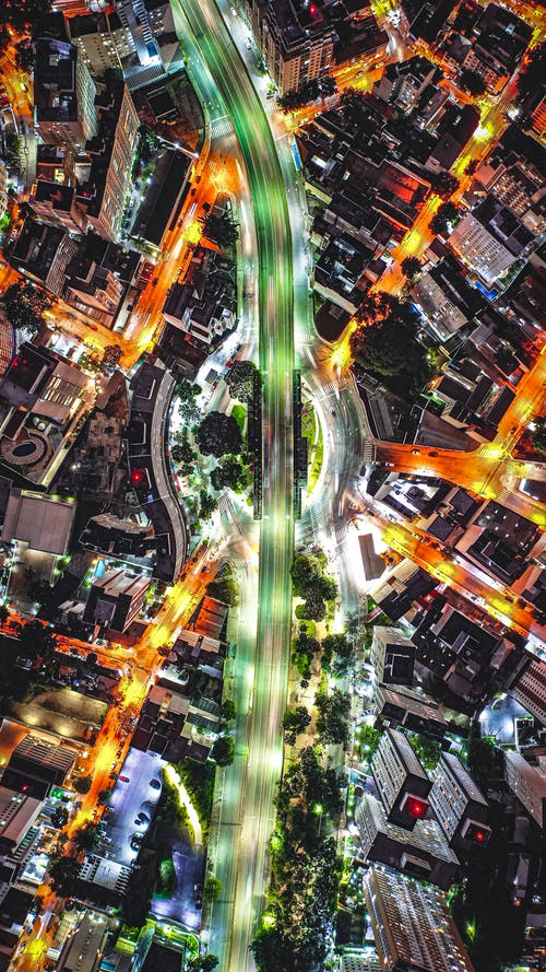 Intersection with roads in modern city at night