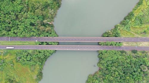 Highway with bridge over turbid river and greenery