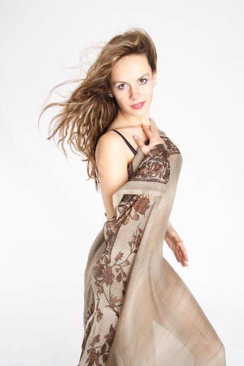 Woman in Brown Floral Spaghetti Strap Dress