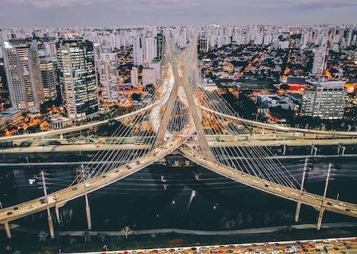 Geometric modern bridge in urban megapolis in evening