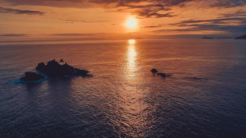 Vibrant sunset over rippling endless sea