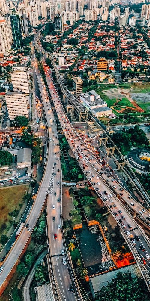 Modern city roads between buildings in megapolis