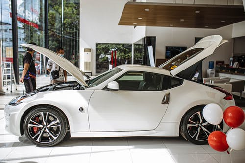 White Porsche 911 Parked in Building