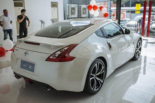 White Porsche 911 Parked in a Room
