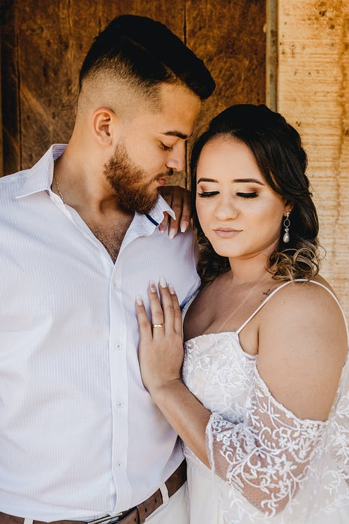 Romantic young couple embracing on wedding day