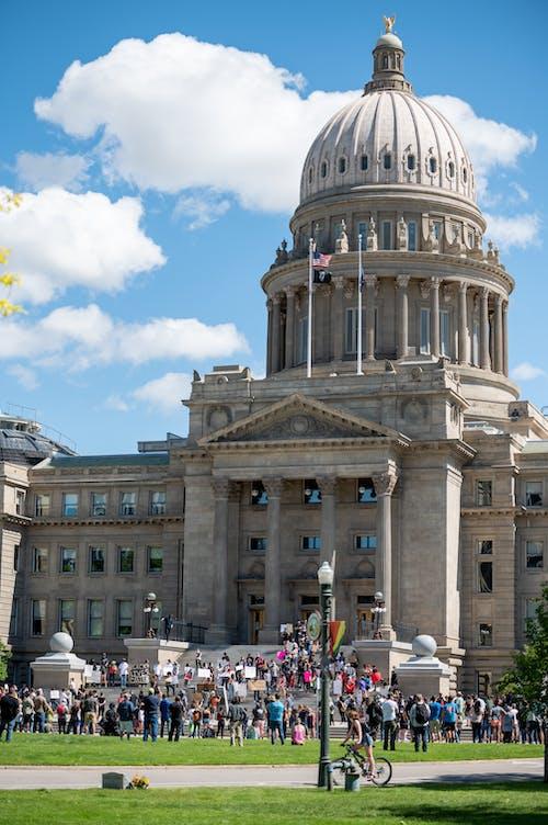 People gathering near majestic Idaho State Capitol palace