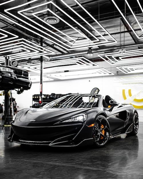 Black Lamborghini Aventador in a Room