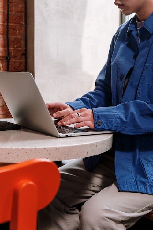 Man in Blue Suit Jacket Using Macbook Pro