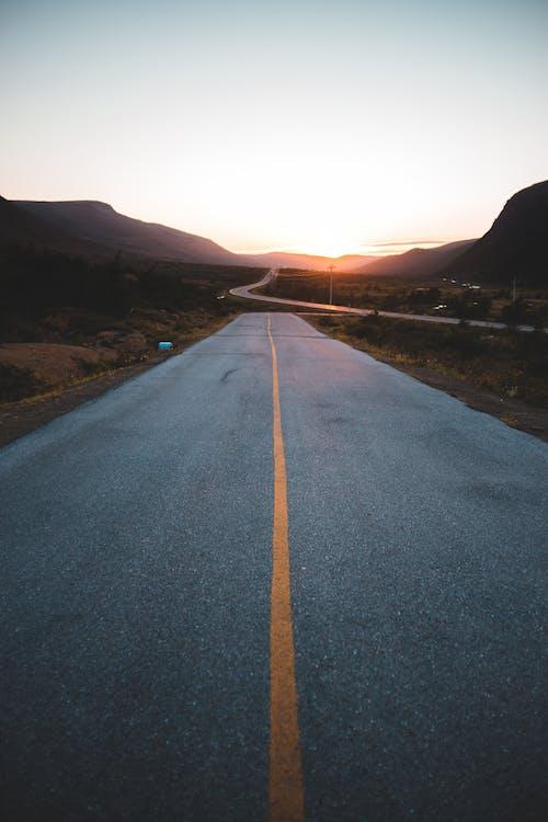 Empty asphalt road in mountains