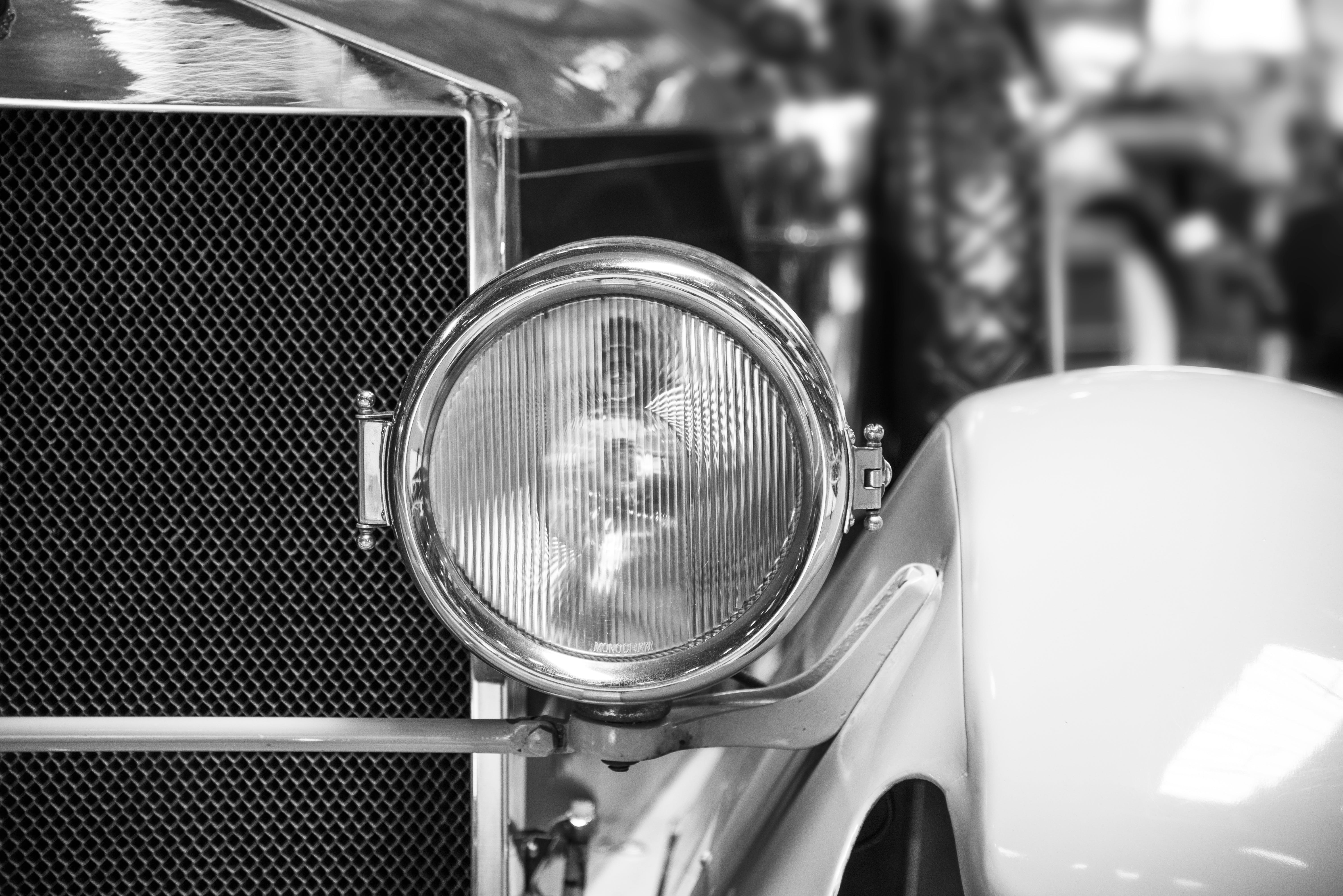 Classic Car Headlight Grayscale Photo