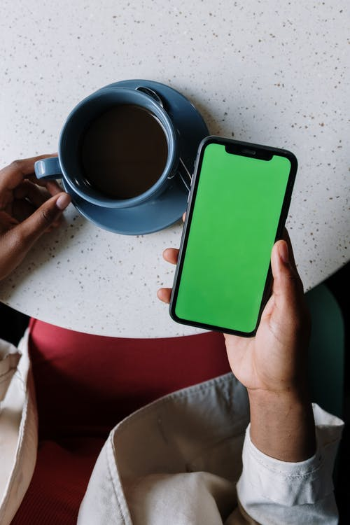 Person Holding Green Iphone 5 C