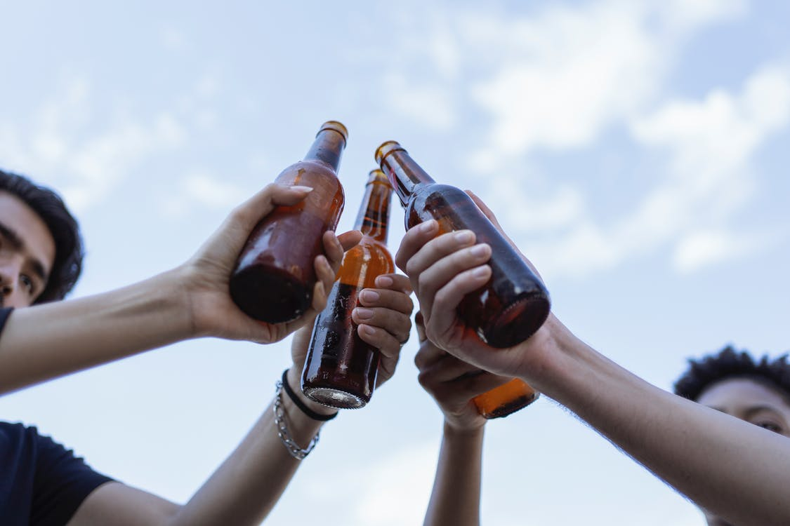 3 Person Holding Bottles