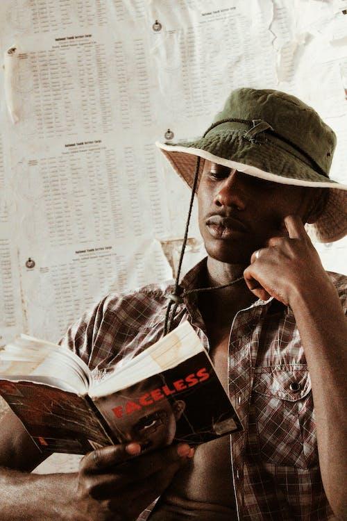 Focused black man reading book