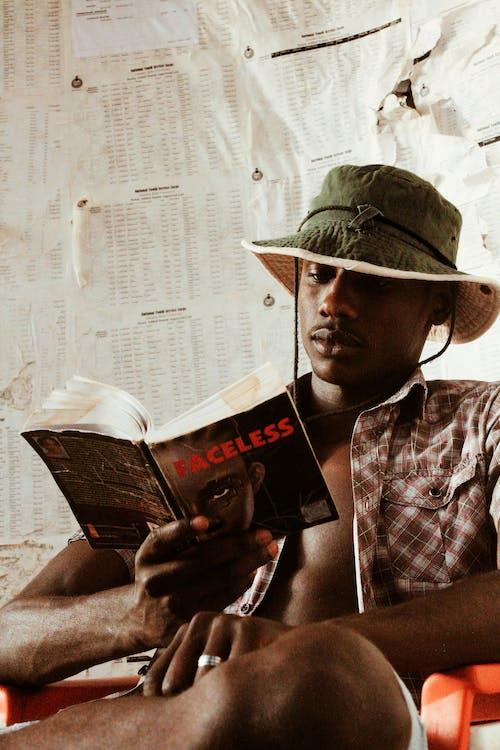 Thoughtful black man reading book