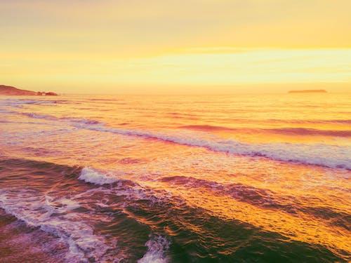 Amazing sunset sky reflecting in waving sea
