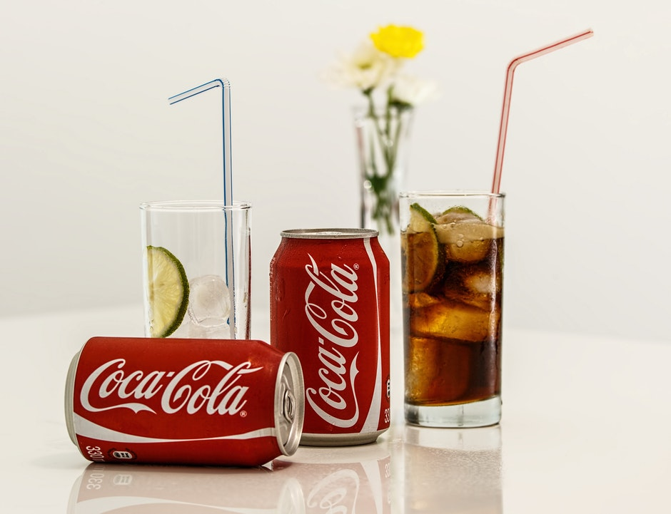 Coca Cola Cans and Glasses With Lines