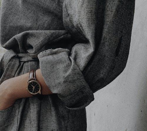 Person in Gray Coat Wearing Silver Watch