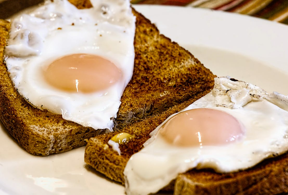 Sunny-side Up Eggs on Toasted Breads