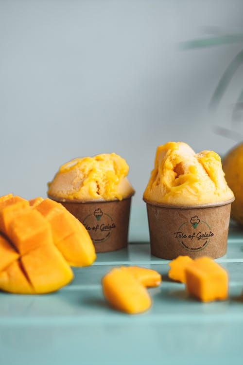 Sliced Mango and Ice Cream on a Cup