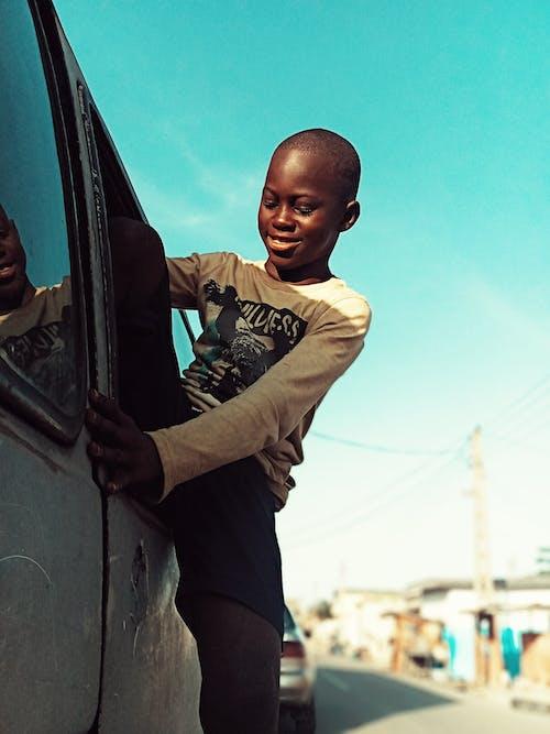 Black boy getting out of car