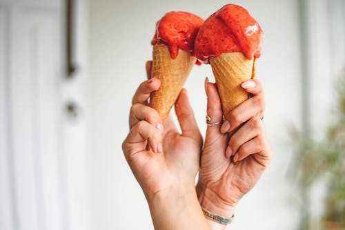 A Person Holding Gelato on Cones