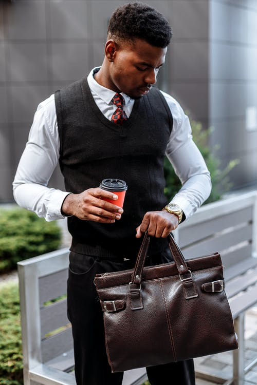 Man in White Dress Shirt Holding Black Cup