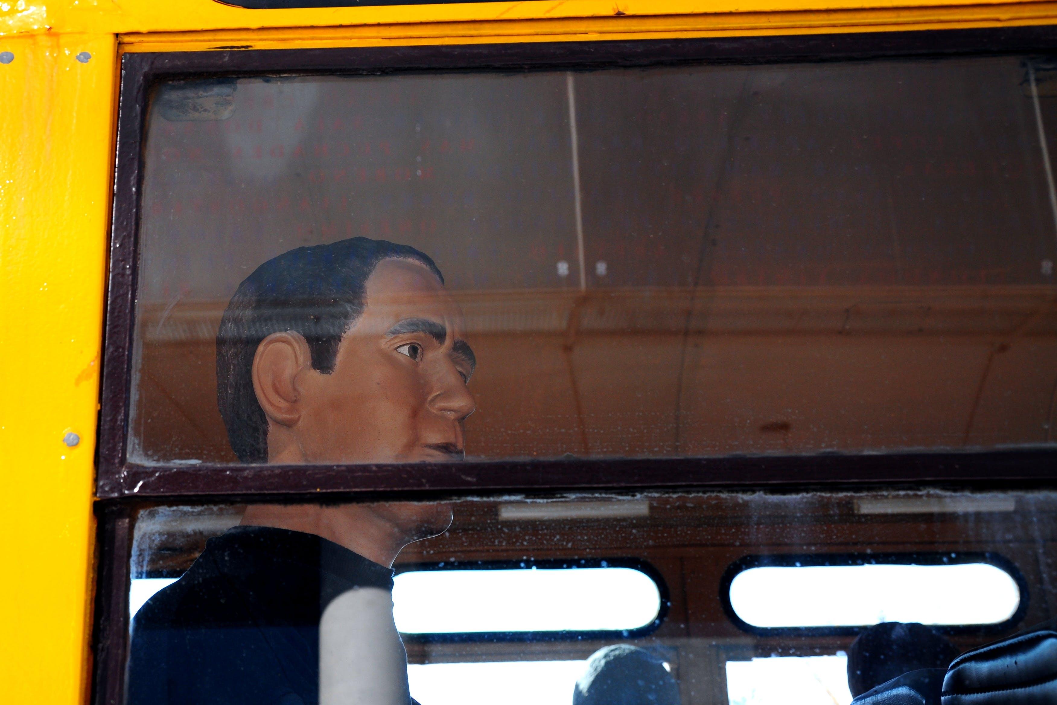 Free stock photo of bus window, mannequin, public transportation, school bus