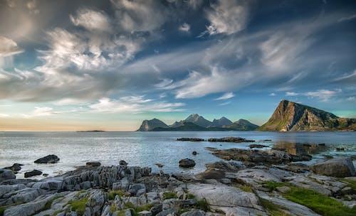 Photos gratuites de aube, bord de mer, caillou, coucher de soleil