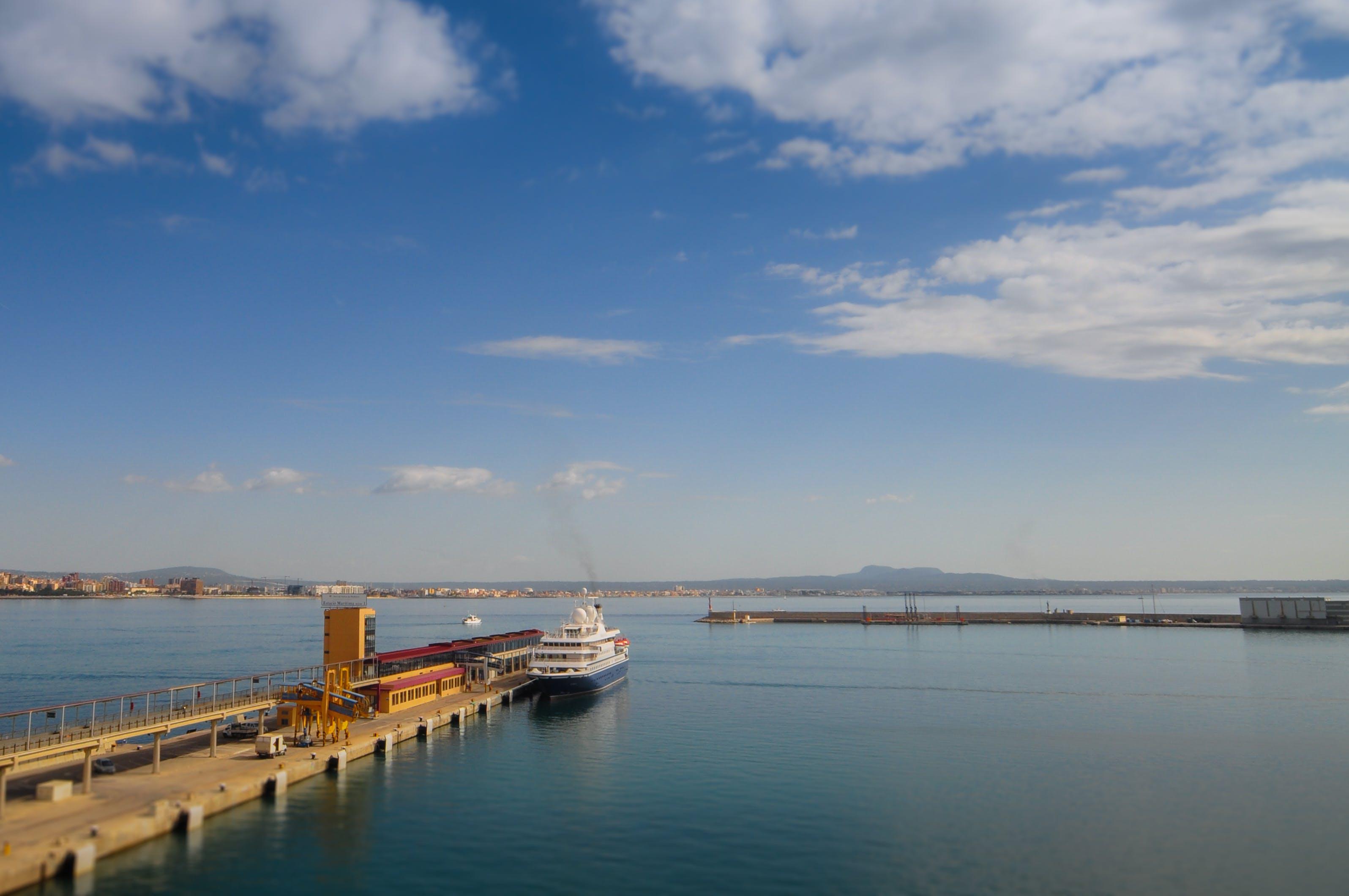 White Cruise Ship Beside Dock