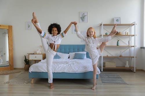 Charming little girls showing splits together