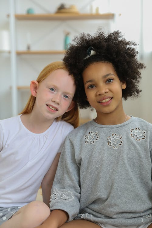 Cheerful Multiethnic girls in room in daytime