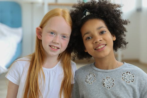 Positive diverse children in bright room