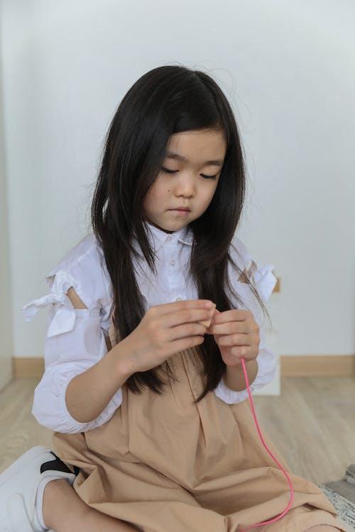 Asian little girl playing on floor