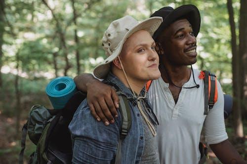 Multiracial men hugging in nature