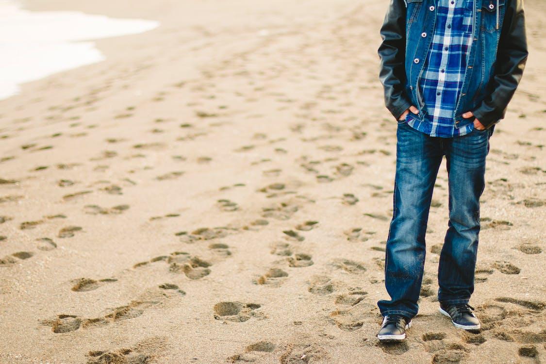 Man Walking on Beachshore