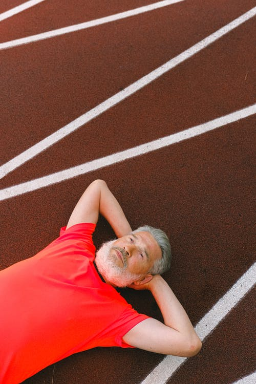 Man Resting on a Race Track