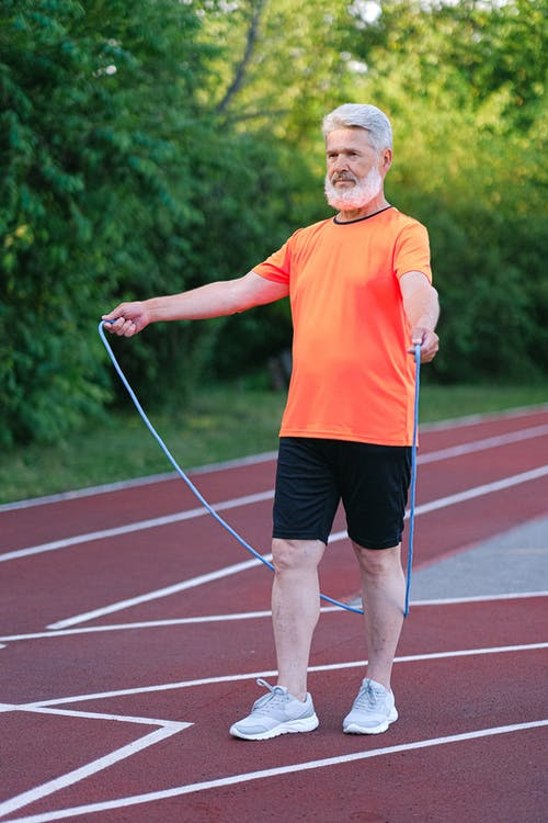Senior man doing exercise with jump rope